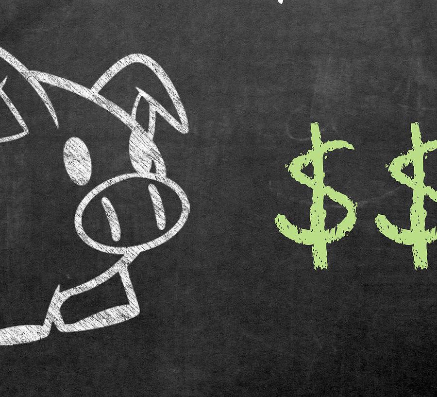 Piggy bank on a blackboard